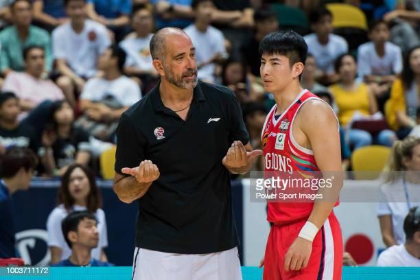 Head coach Juan Antonio Orenga Forcada of Guangzhou Long Lions speaks to is player Heng Yifeng during the Summer Super 8 Final game between Seoul...