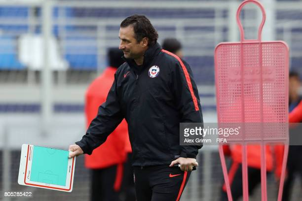 Head coach Juan Antonio Pizzi walks over the pitch during a Chile training session ahead of their FIFA Confederations Cup Russia 2017 final against...