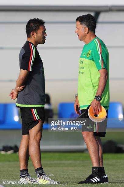 Head coach Juan Carlos Osorio talks to Marco Fabian during a Mexico training session at Adler training ground ahead of their FIFA Confederations Cup...