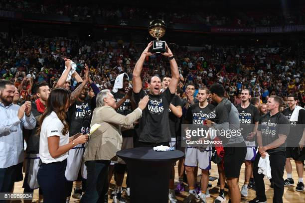 Head Coach Jud Buechler of the Los Angeles Lakers hoists the NBA Summer League Championship trophy after the game against the Portland Trail Blazers...