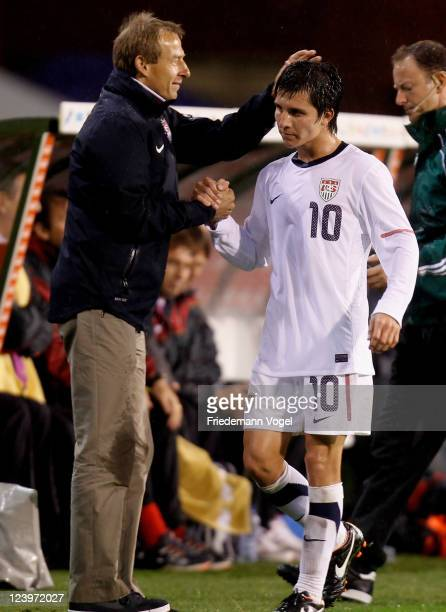 Head coach Juergen Klinsmann and Jose Torres of the United States shake hands during the international friendly match between Belgium and USA at Roi...