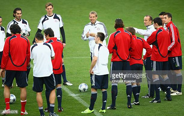 Head coach Juergen Klinsmann issues instructions to the team during the FC Bayern Muenchen training session prior to tomorrow's Champions League...