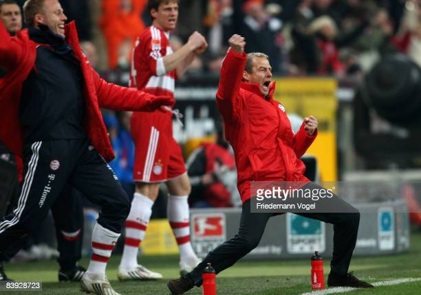 Head coach Juergen Klinsmann of Bayern celebrates after the first goal during the Bundesliga match between Bayern Muenchen and 1899 Hoffenheim at the...