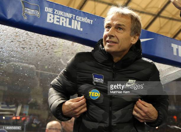 Head coach Juergen Klinsmann of Berlin looks on prior to the Bundesliga match between Hertha BSC and Borussia Moenchengladbach at Olympiastadion on...