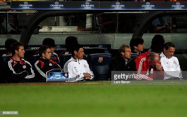Head coach Juergen Klinsmann of Munich looks dejected next to manager Uli Hoeness and players Michael Rensing and Philipp Lahm during the UEFA...