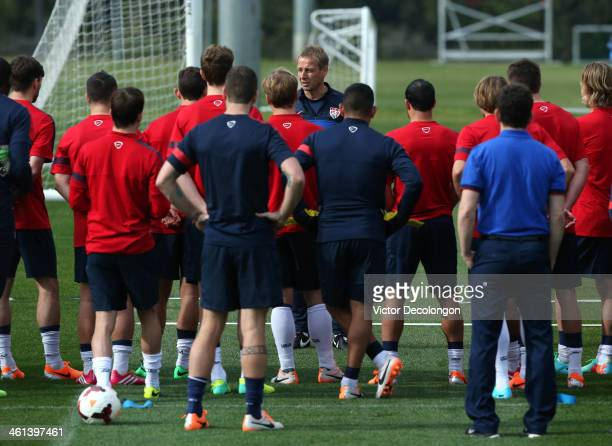Head Coach Juergen Klinsmann of the US Men's National Soccer team addresses his players during training at StubHub Center on January 7 2014 in Los...