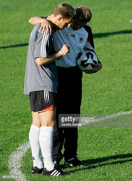 Head Coach Juergen Klinsmann talks with his player Lukas Podolski during the training session of the German National Team for the Confederations Cup...