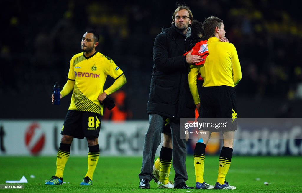 Head coach Juergen Klopp and his players are looking dejected after loosing during the UEFA Champions League group F match between Borussia Dormtund and Olympique de Marseille at Signal Iduna Park on December 6, 2011 in Dortmund, Germany.