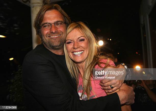 Head coach Juergen Klopp and his wife Ulla Klopp pose afterwinning the German Championships at a restaurant on April 30 2011 in Dortmund Germany