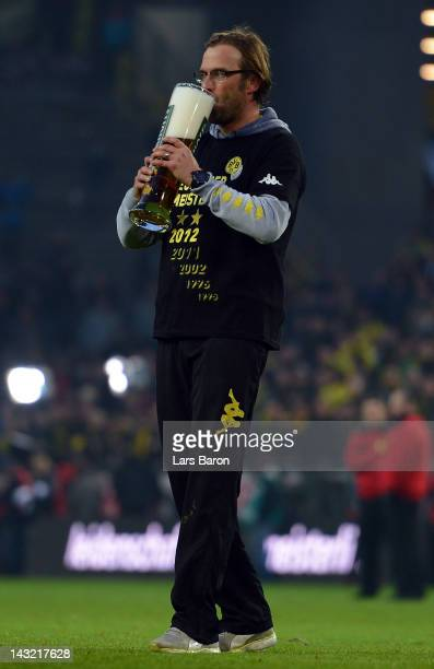Head coach Juergen Klopp celebrates with a beer after winning the Bundesliga match between Borussia Dortmund and Borussia Moenchengladbach at Signal...