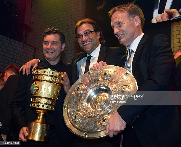 Head coach Juergen Klopp celebrates with manager Michael Zorc and managing director Hans Joachim Watzke during the Borussia Dortmund party at the...