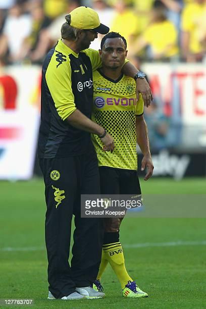 Head coach Juergen Klopp embraces Antonio da Silva of Dortmund after winning 40 the Bundesliga match between Borussia Dortmund and FC Ausgburg at...