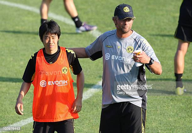 Head coach Juergen Klopp embraces Shinji Kagawa during the Borussia Dortmund Training Camp for the upcoming season 2010/2011 on July 19 2010 in...