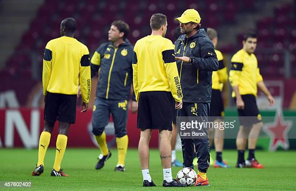 Head coach Juergen Klopp gives instructions to Kevin Grosskreutz during a Borussia Dortmund training session ahead of their Champions League match...