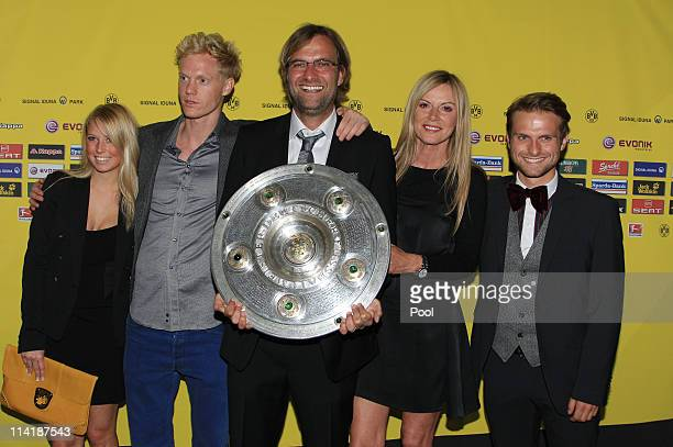 Head coach Juergen Klopp his wife Ulla Klopp his son Marc Klopp Ulla's son and his girlfriend pose with the German Championship trophy during the...