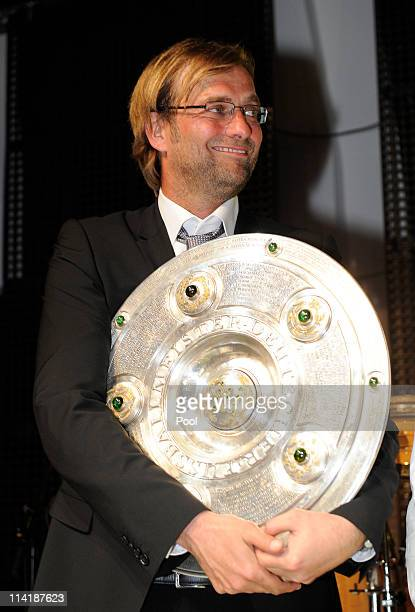 Head coach Juergen Klopp holds the German Championship trophy during the dinner to celebrate their German Bundesliga 2010/2011 victory on May 14,...