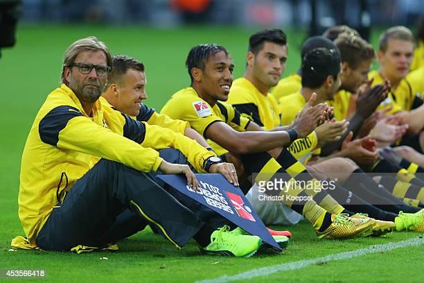 Head coach Juergen Klopp Kevin Grosskreutz PierreEmerick Aubameyang and Milos Jojic of Dortmund celebrate after winning 20 the DFL Supercup match...