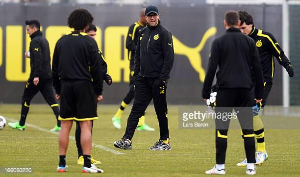 Head coach Juergen Klopp looks on during a Borussia Dortmund training session ahead of their UEFA Champions League quarterfinal match against Malaga...
