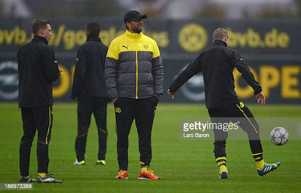 Head coach Juergen Klopp looks on during a Borussia Dortmund training session ahead of the UEFA Champions League Group F match against Arsenal on...