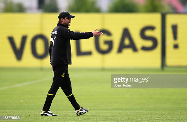 Head coach Juergen Klopp of Borussia Dortmund gestures during a training session during the UEFA Champions League Finalist Media Day at the Training...