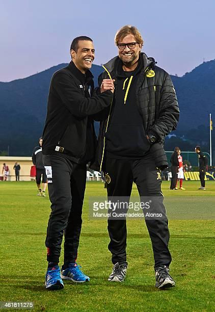 Head coach Juergen Klopp of Borussia Dortmund greets to head coach Guy Luzon of Standard de Liege after the friendly match between Borussia Dortmund...