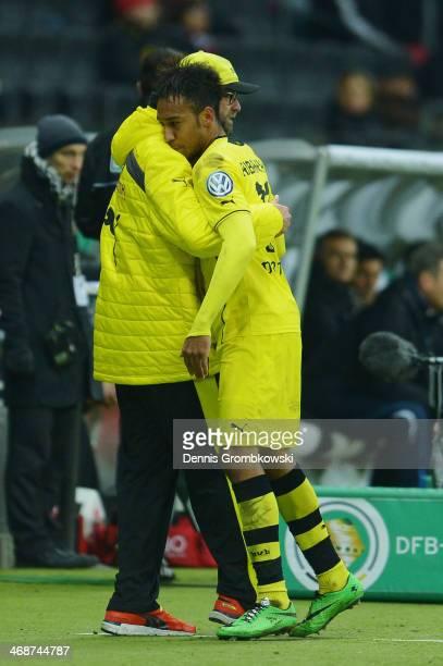 Head coach Juergen Klopp of Borussia Dortmund hugs PierreEmerick Aubameyang during the DFB Cup quarterfinal match between Eintracht Frankfurt and...