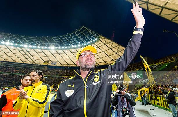 Head coach Juergen Klopp of Borussia Dortmund is saying goodbye to his fans after the final whistle during the DFB Cup Final match between Borussia...