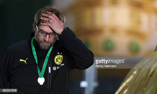 Head coach Juergen Klopp of Borussia Dortmund looks dejected after losing his final match for Borussia Dortmund in the DFB Cup Final match 2014...