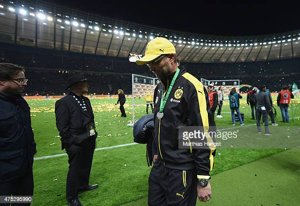 Head coach Juergen Klopp of Borussia Dortmund reacts after receiving his second place medal in the DFB Cup Final match between Borussia Dortmund and...