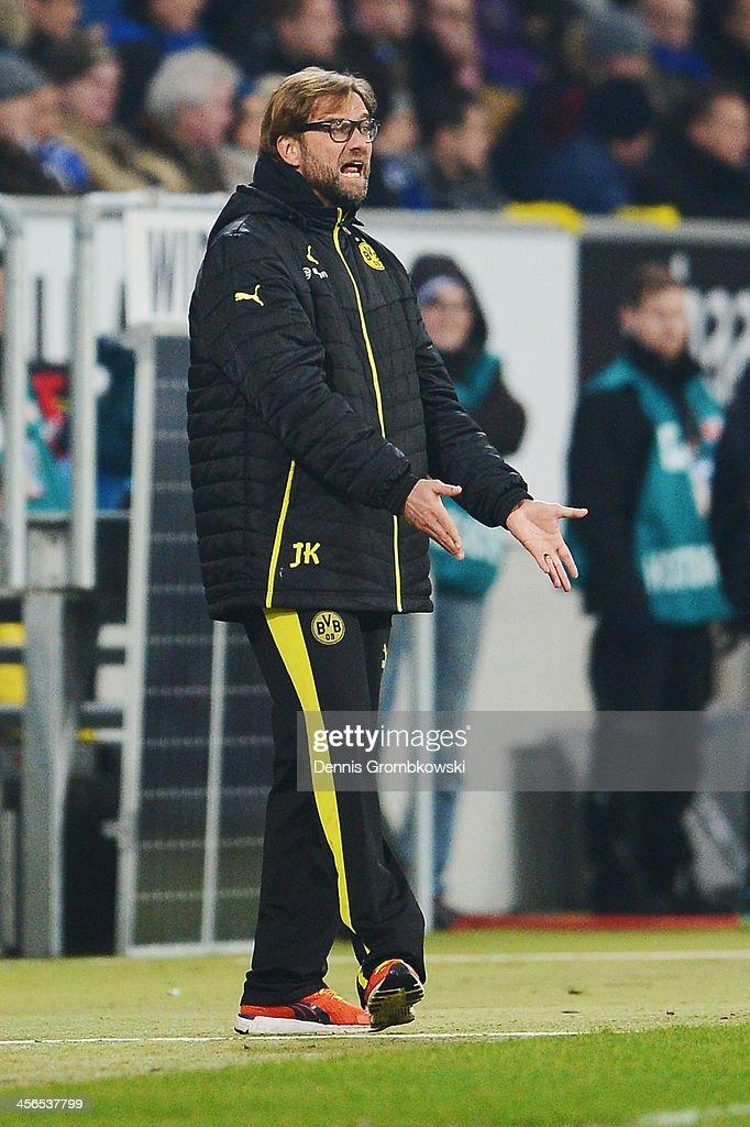 Head coach Juergen Klopp of Borussia Dortmund reacts during the Bundesliga match between 1899 Hoffenheim and Borussia Dortmund at Rhein-Neckar-Arena on December 14, 2013 in Sinsheim, Germany.