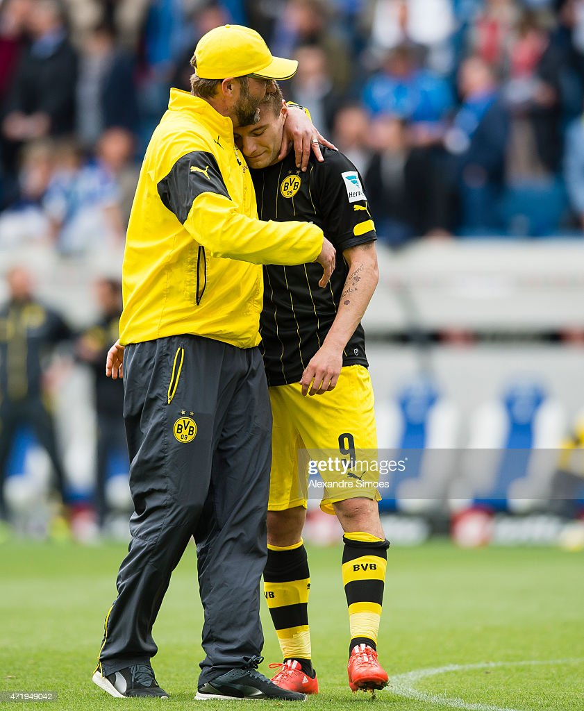Head coach Juergen Klopp of Borussia Dortmund together with his player Ciro Immobile after the final whistle during the Bundesliga match between 1899 Hoffenheim and Borussia Dortmund at Wirsol Rhein-Neckar-Arena on May 02, 2015 in Sinsheim, Germany.
