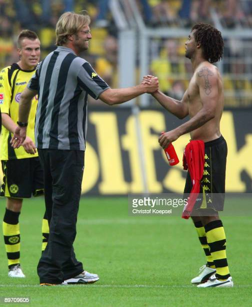 Head coach Juergen Klopp of Dortmund and Patrick Owomoyela of Dortmund celebrate the 1-0 victory after the Bundesliga match between Borussia Dortmund...