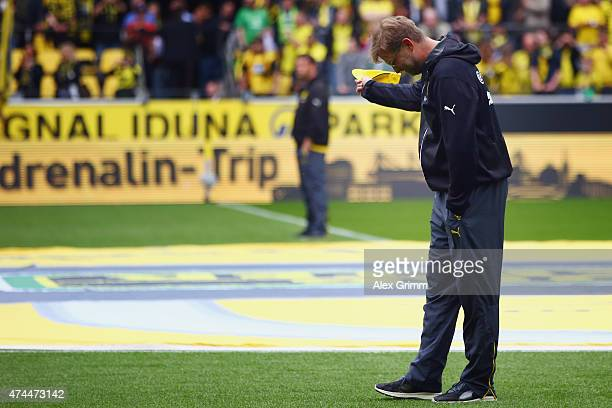 Head coach Juergen Klopp of Dortmund bows to the fans prior to the Bundesliga match between Borussia Dortmund and Werder Bremen at Signal Iduna Park...