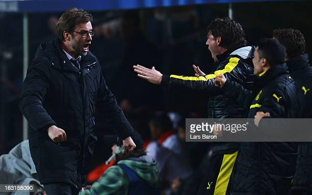 Head coach Juergen Klopp of Dortmund celebrates after Felipe Santana scores his teams first goal during the UEFA Champions League round of 16 second...