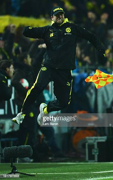 Head coach Juergen Klopp of Dortmund celebrates after MArco Reus scored his teams third goal during the Bundesliga match between Borussia Dortmund...