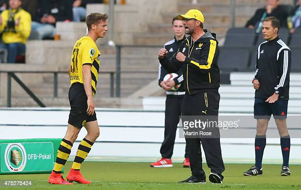 Head coach Juergen Klopp of Dortmund celebrates after PierreEmerick Aubameyang of Borussia Dortmund scored his teams first goal during the DFB Cup...