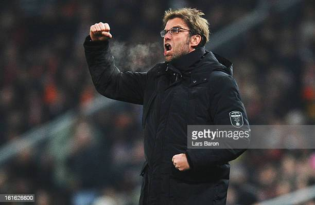 Head coach Juergen Klopp of Dortmund celebrates after Robert Lewandowski scored his teams first goal during the UEFA Champions League Round of 16...