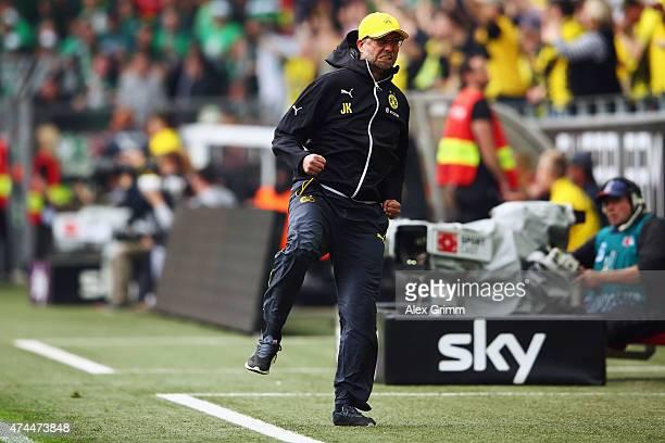 Head coach Juergen Klopp of Dortmund celebrates his team's first goal during the Bundesliga match between Borussia Dortmund and Werder Bremen at...