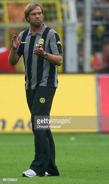 Head coach Juergen Klopp of Dortmund celebrates the 1-0 victory after the Bundesliga match between Borussia Dortmund and 1. FC Koeln at the Signal...