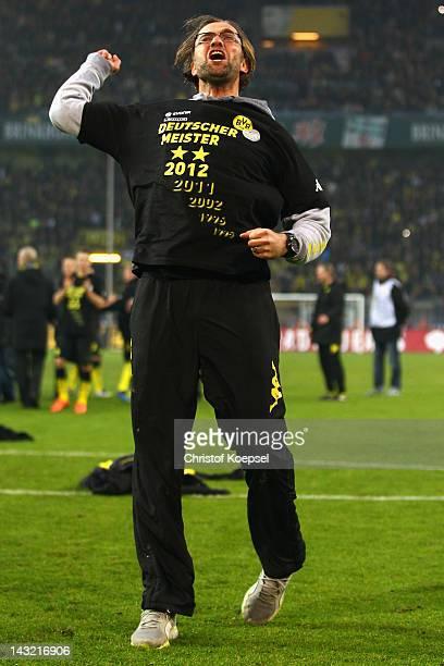 Head coach Juergen Klopp of Dortmund celebrates winning 20 and the German Championships after the 1 Bundesliga match between Borussia Dortmund an...