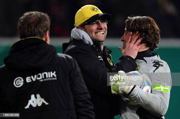 Head coach Juergen Klopp of Dortmund celebrates with goalkeeper Roman Weidenfeller after winning the DFB Cup third round match between Fortuna...