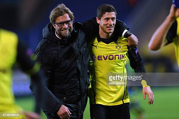 Head coach Juergen Klopp of Dortmund celebrates with Robert Lewandowski after the UEFA Champions League Round of 16 match between FC Zenit and...