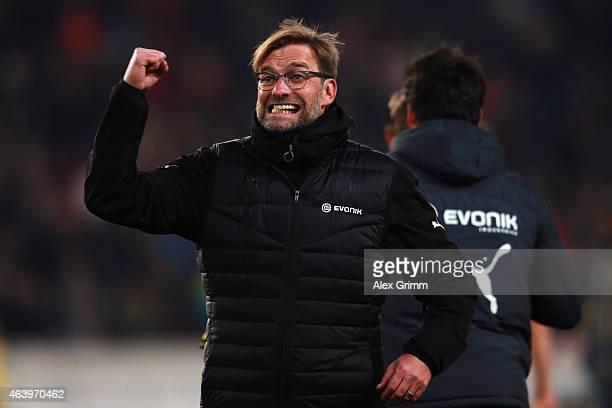 Head coach Juergen Klopp of Dortmund celebrates with the fans after the Bundesliga match between VfB Stuttgart and Borussia Dortmund at MercedesBenz...