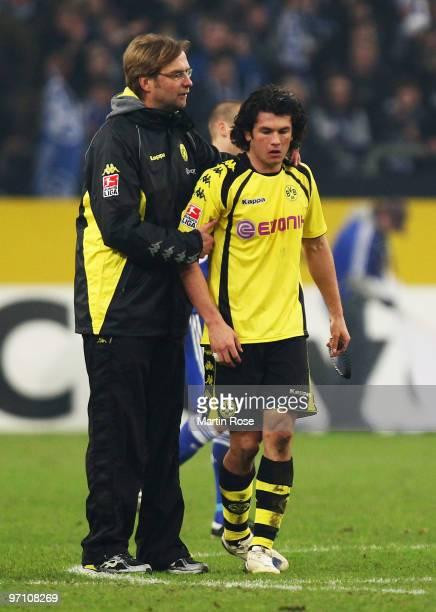 Head coach Juergen Klopp of Dortmund comforts Nelson Valdez after the Bundesliga match between FC Schalke 04 and Borussia Dortmund at the Veltins...