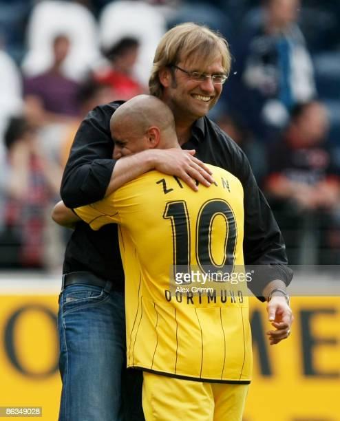 Head coach Juergen Klopp of Dortmund hugs Mohamed Zidan after the Bundesliga match between Eintracht Frankfurt and Borussia Dortmund at the...