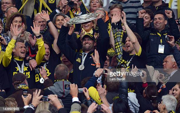 Head coach Juergen Klopp of Dortmund lifts the trophy after the Bundesliga match between Borussia Dortmund and SC Freiburg at Signal Iduna Park on...