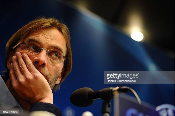 Head coach Juergen Klopp of Dortmund looks on during a press conference ahead of their UEFA Champions League group match against Olympique de...