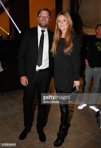 Head coach Juergen Klopp of Dortmund pose with his wife Ulla Klopp during the Borussia Dortmund Champions party after the DFB Cup final 2015 at...