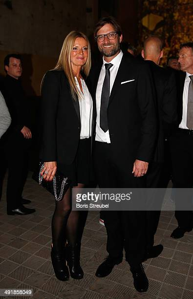 Head coach Juergen Klopp of Dortmund pose with his wife Ulla Klopp during the Borussia Dortmund Champions party after the DFB Cup final 2014 at...