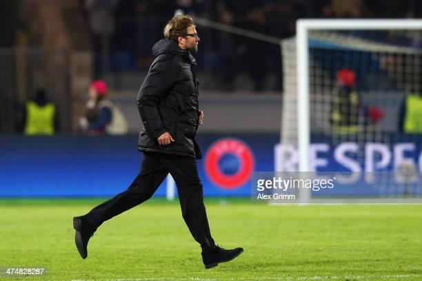 Head coach Juergen Klopp of Dortmund runs after the first half of the UEFA Champions League Round of 16 match between FC Zenit and Borussia Dortmund...
